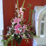 A hanging basket of pink roses and Daffodils