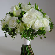 A bouquet of white roses, Freesia and Condor Hypericum